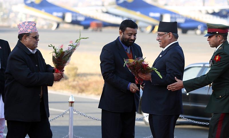Deputy Prime Minister duo Krishna Bahadur Mahara (l) and Bimalendra Nidhi (C) welcome Prime Minister Pushpa Kamal Dahal at the Tribhuvan Interational Airport in Kathmandu upon his return from the United Arab Emirates on Tuesday, January 17, 2017. Photo: RSS
