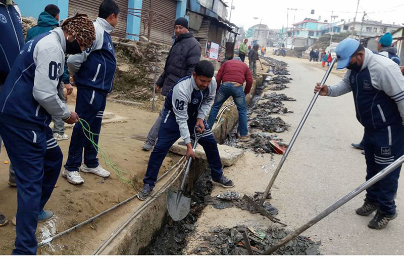 Youth of the local Ekata Club are seen cleaning a market of Tuphandanda in Dadeldhura district on Monday, January 9, 2016. Photo: Rss