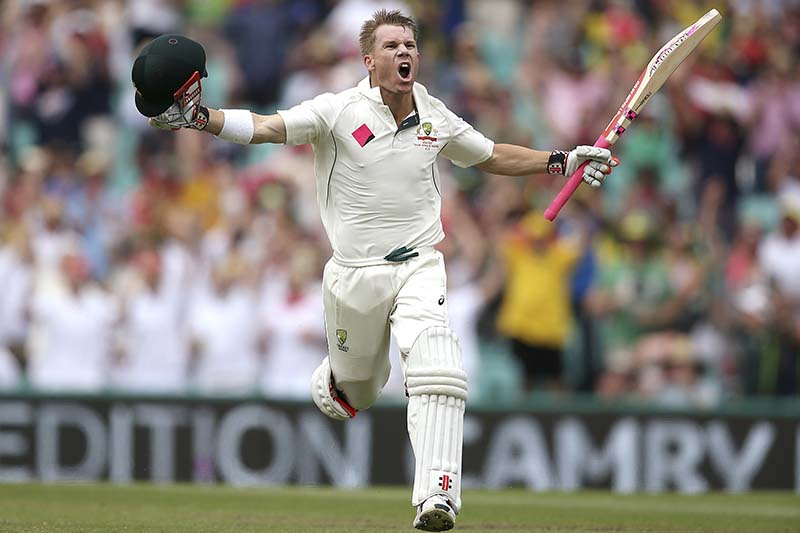 Australia's David Warner raises his arms to celebrate making 100 runs against Pakistan during their cricket test match in Sydney, Australia, on Tuesday, January 3, 2017. Photo: AP