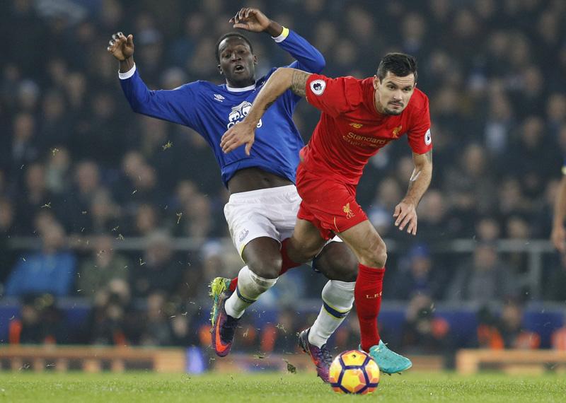 Liverpool's Dejan Lovren in action with Everton's Romelu Lukaku. Photo: Reuters