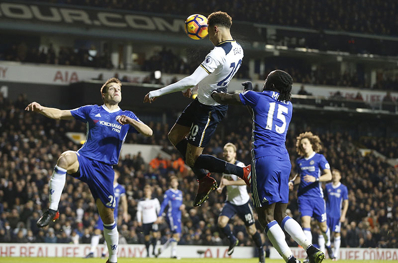 Tottenham's Dele Alli (centre) scores a goal during the English Premier League soccer match between Tottenham Hotspur and Chelsea at White Hart Lane stadium in London, on Wednesday, January 4, 2017. Photo: AP