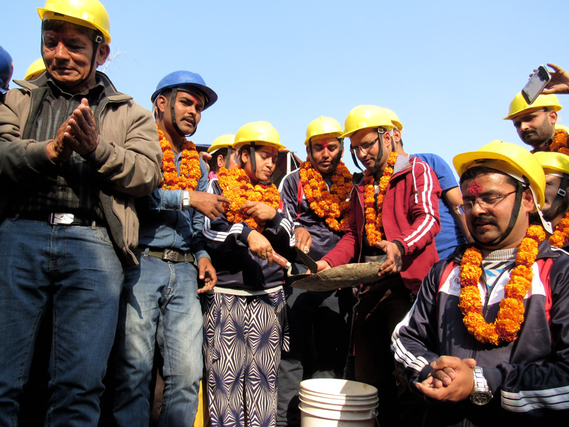 Actors Sitaram Kattel (Dhurmus) and Kunjana Ghimire (Suntali) among others prepare to lay the foundation stone for the third model earthquake-resistant settlement for a Musahar community in Mahottari district, on Monday, January 9, 2017. Photo: Dhurmus Suntali Foundation