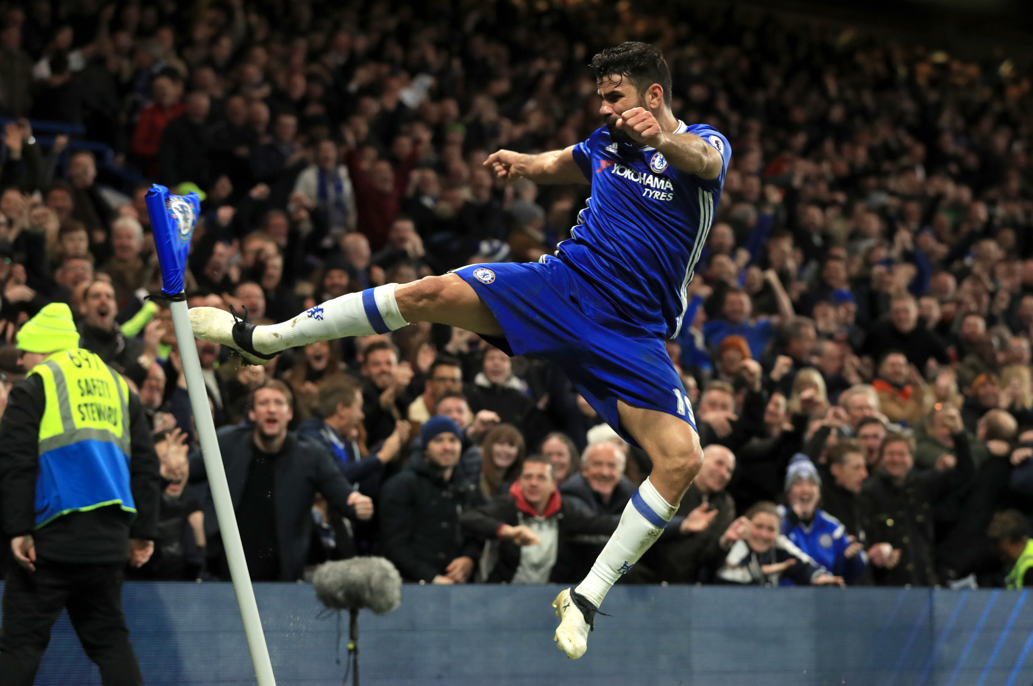 Chelsea's Diego Costa celebrates scoring his side's fourth goal of the game during their English Premier League soccer match against Middleborough at Stamford Bridge, London, on Saturday, December 31, 2016. Photo: Adam Davy/PA via AP