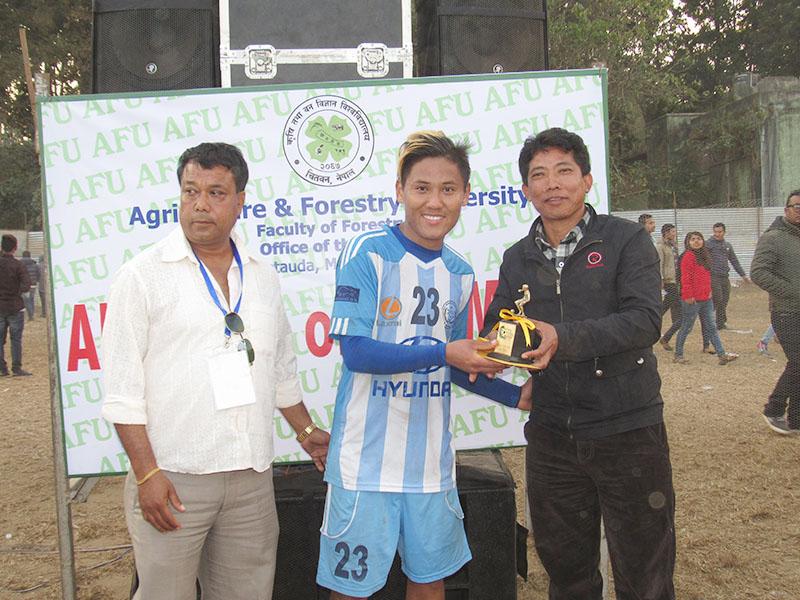 MMCu2019s Dona Thapa receiving man-of-the-match trophy from CPN-Maoist Centre Makwanpur President PremBahadurPulami on Sunday, January 1, 2017. Photo: THT