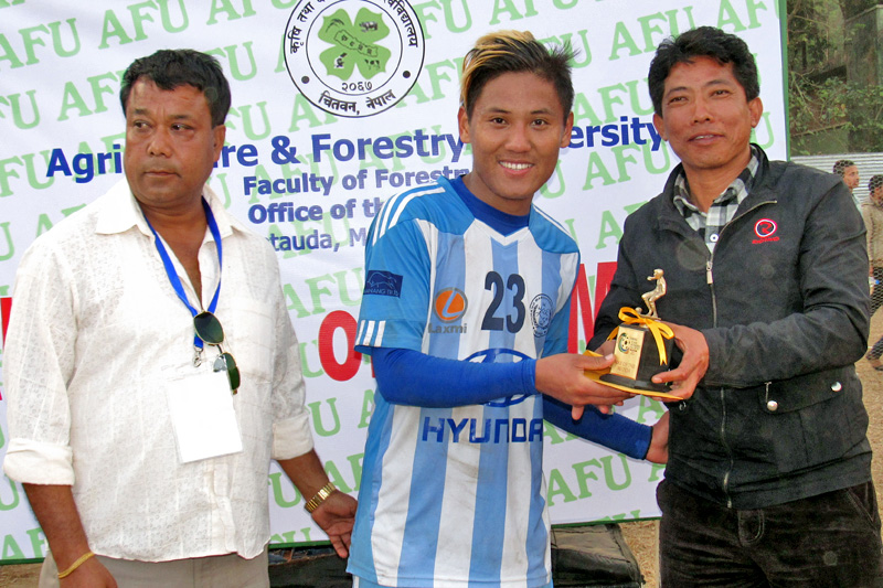 Manang Marsyangdi Club's Dona Thapa receives the Man of the Match trophy after a match against the APF Club in Hetaunda, on Sunday, January 1, 2017. Photo: Prakash Dahal