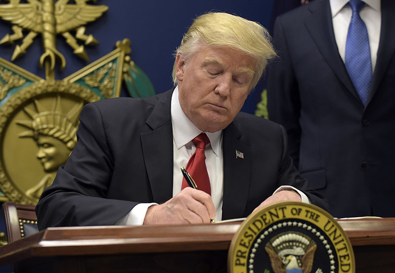 President Donald Trump signs an executive order on extreme vetting during an event at the Pentagon in Washington, on Friday, January 27, 2017. Photo: AP