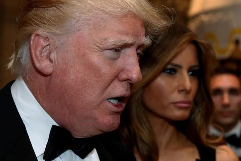 File Photo: US President-elect Donald Trump talks to reporters as he and his wife Melania Trump arrive for a New Year's Eve celebration with members and guests at the Mar-a-lago Club in Palm Beach, Florida, US, on December 31, 2016. Photo: Reuters