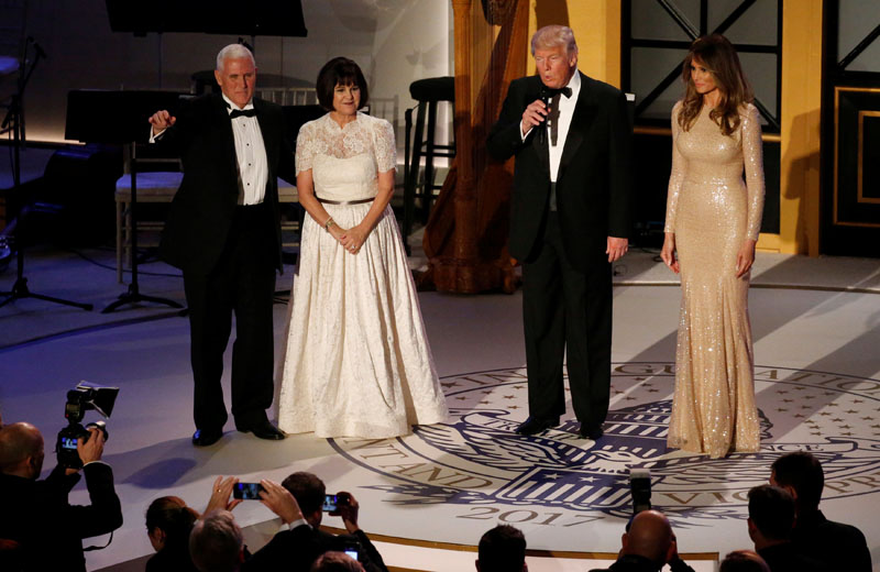 US President-elect Donald Trump (2nd from left) and his wife Melania take the stage with Vice President-elect Mike Pence (left) and his wife Karen at a pre-inauguration candlelight dinner with supporters at Union Station in Washington, US on January 19, 2017. Photo: Reuters