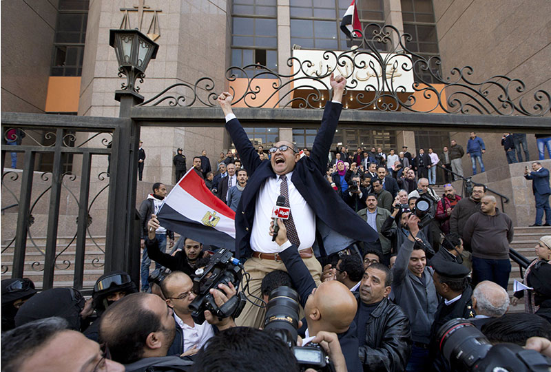 Lawyer and former presidential candidate Khaled Ali (center) celebrates with others after the Supreme Administrative Court said two islands, Sanafir and Tiran, are Egyptian, debunking the government's claim that they were Saudi, in Cairo, Egypt, on Monday, January 16, 2017. Photo: AP