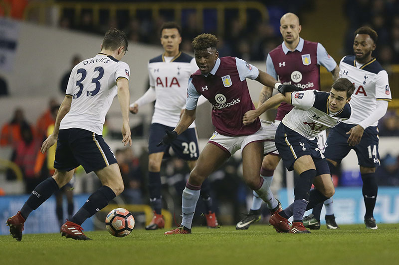 Aston Villa's Aaron Tshibola (centre) competes for the ball with Tottenham's Ben Davies (left) and Tottenham's Harry Winks during the English FA Cup third round match between Tottenham Hotspur and Aston Villa at White Hart Lane in London, on Sunday, January 8, 2017. Photo: AP