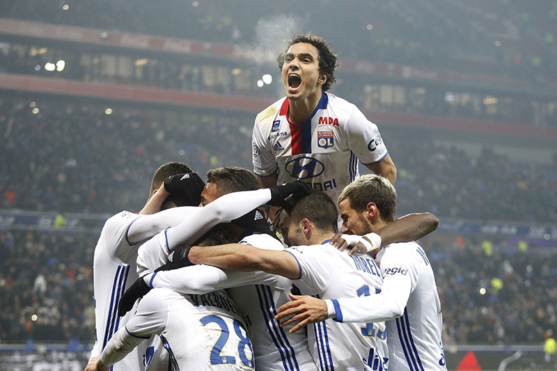 Lyon's Rafael Pereira Da Silva celebrates with teammates after Lacazette scored a goal against Marseille during their French League One soccer match in Decines, near Lyon, central France, on Sunday, January 22, 2017. Photo: AP