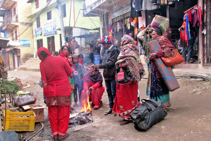 Locals and pedestrians gather around a fire to warm themselves in Khalanga Bazaar of Rukum district, on Thursday, January 12, 2017. Photo: RSS
