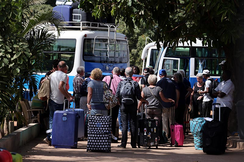 Tourists are seen gathered as they board buses leaving for the airport a day after the country declared a state of emergency, in Banjul, Gambia    January 18, 2017.   REUTERS/Afolabi Sotunde