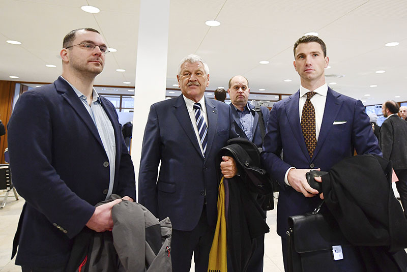 NPD party leader Frank Franz (right) NPD's member of the European Parliament, Udo Voigt, and head of the Berlin NPD Sebastian Schmidtke (left) go through the security check before the verdict to outlaw a far-right party NPD at the German constitutional court in Karlsruhe, southern Germany, on January 17, 2017. Photo: Uwe Anspach/dpa via AP