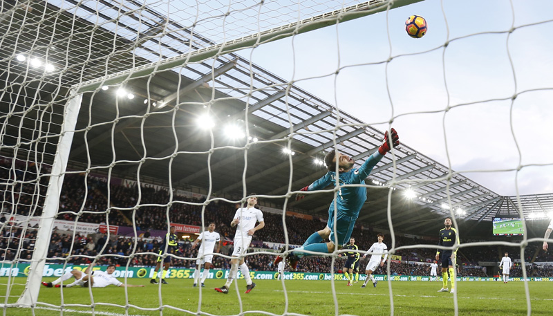 Swansea City's Jack Cork scores an own goal and the second goal for Arsenal. Photo: Reuters