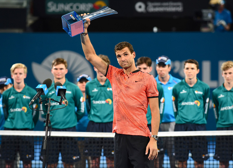 Bulgaria's Grigor Dimitrov holds the trophy after defeating Japanu2019s Kei Nishikori in the Men's singles final. Photo: Reuters