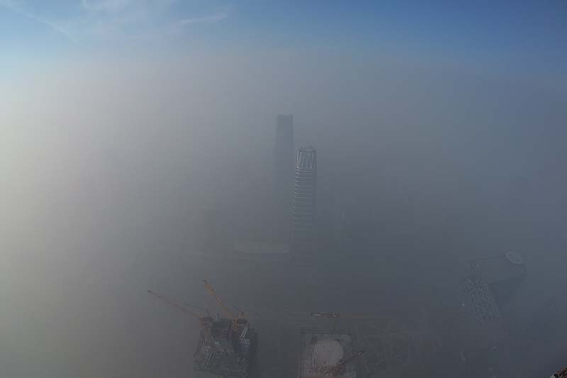 Smog is seen over the city against sky during a haze day in Beijing, China, on January 1, 2017. Photo: Reuters