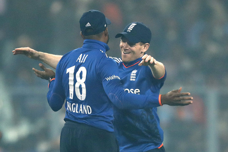 England's captain Eoin Morgan (right) hugs his teammate after wining their third one day international cricket match against India at Eden Gardens in Kolkata, India, on Sunday, January 22, 2017. Photo: AP