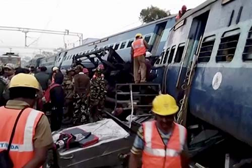 In this image from video, rescuers work around coaches of a derailed passenger train in Kuneru, Andhra Pradesh, southern India, on Sunday, January 22, 2017. Photo: KK Production via AP
