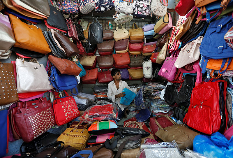 A vendor arranges bags as he waits for customers at his shop at a market in Mumbai, India, on January 6, 2017.