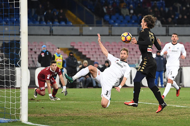 Napoli's forward Manolo Gabbiadini (right) scores during an Italy Cup round of 16 soccer match between Napoli and Spezia, at San Paolo stadium in Naples, southern Italy, on Tuesday, January 10, 2017. Photo: Ciro Fusco/ANSA via AP