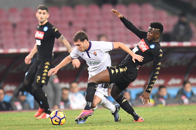 Forentina's Cristoforo (centre), is challenged by Napoli's Amadou Diawara during an Italian Cup, Round of 8 soccer match between Napoli and Fiorentina, at the San Paolo stadium in Naples, Italy, on Tuesday, January 24, 2017. Photo: Ciro Fusco/ANSA via AP