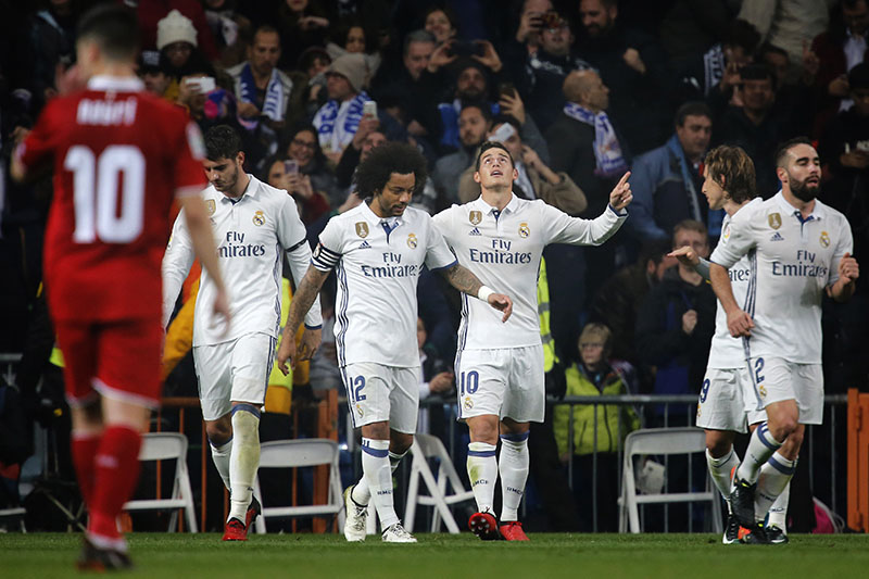 Real Madrid's James Rodriguez from Colombia (center right) celebrates after scoring a goal during a Spain's King's Cup soccer match between Real Madrid and Sevilla CF at the Santiago Bernabeu stadium in Madrid, Spain, on Wednesday, January 4, 2017. Photo: AP
