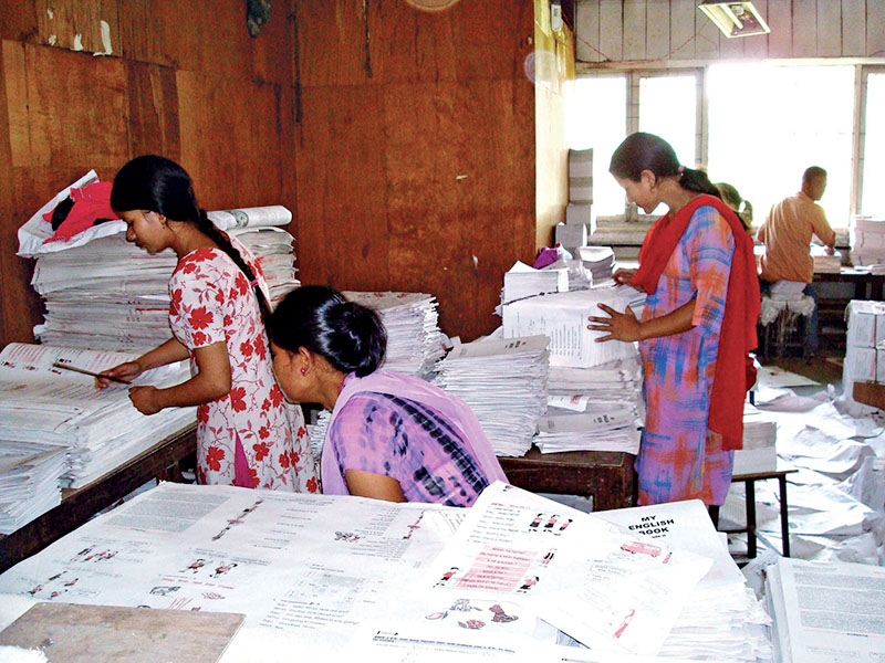 File - The employees of government-owned Janak Education Material Centre (JEMC) binding textbooks. Photo: RSS