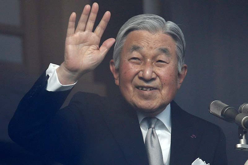 File-Japanese Emperor Akihito waves to well-wishers during a public appearance for New Year celebrations at the Imperial Palace in Tokyo, Japan, on January 2, 2017. Photo: Reuters