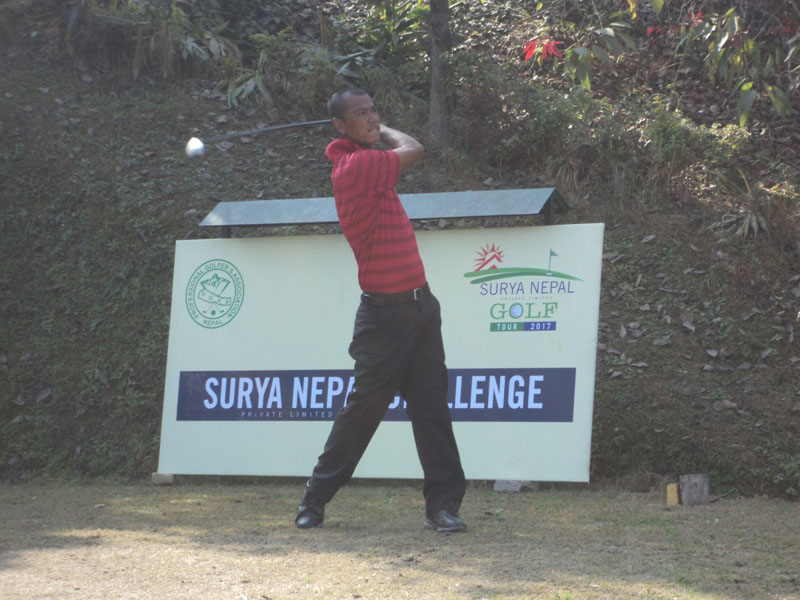 Jayaram Shrestha plays a shot from the 10th tee box during the second round of the Surya Nepal Challenge at the Royal Nepal Golf Club in Kathmandu on Wednesday., January 11, 2016. Photo courtesy: Nepal PGA