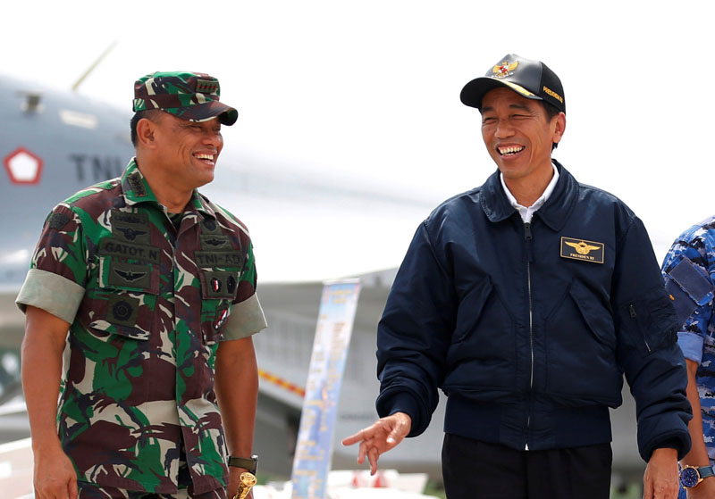 File - Indonesia's President Joko Widodo (right) talks with military Chief Gatot Nurmantyo as walk past fighter jets and weapons during a military exercise on Natuna Island, Riau Islands province, Indonesia on October 6, 2016. Photo: Reuters