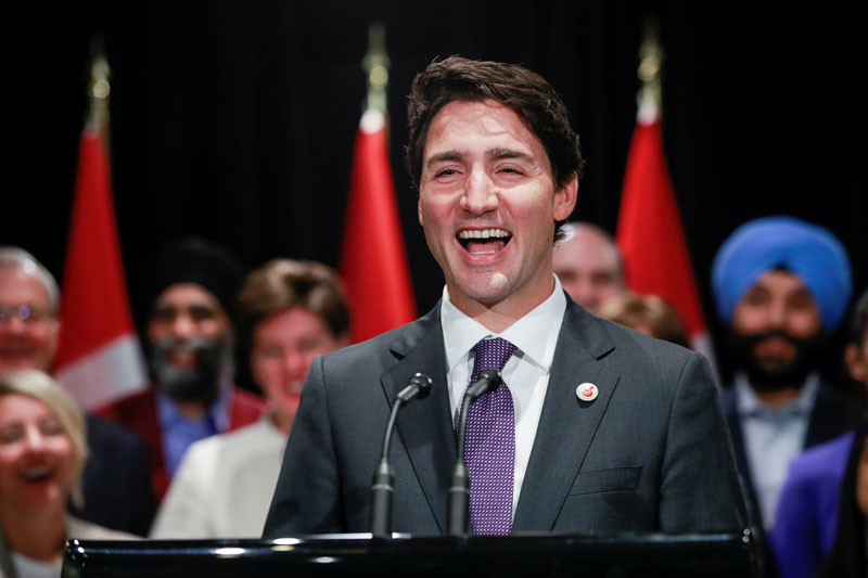 Canada's Prime Minister Justin Trudeau laughs after being asked a question from the media at the end of a two-day cabinet retreat in Calgary, Alberta, Canada, on January 24, 2017. Photo:Reuters