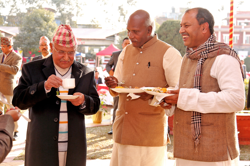 CPN-UML Chairman KP Sharma Oli and Madhesi leaders share a light moment during a tea reception organised by President Bidya Devi Bhandari on the occasion of Mange Sankranti at the Sheetal Niwas, in Kathmandu, on Saturday, January 14, 2017. Photo: RSS