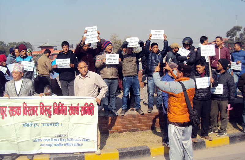 Supporters of the Kathmandu Valley Road Extension Struggle Committee protest the road expansion works by the government in the Kathmandu Valley without providing due compensation to the public affected from it, at Maitighar Mandala in Kathmandu on Monday, January 9, 2016. Photo: RSS