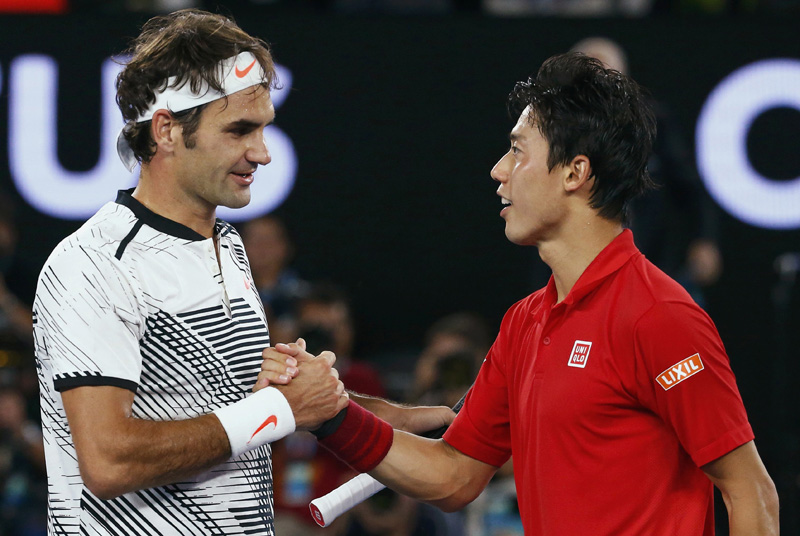 Switzerland's Roger Federer shakes hands after winning his Men's singles fourth round match against Japan's Kei Nishikori. Photo: Reuters