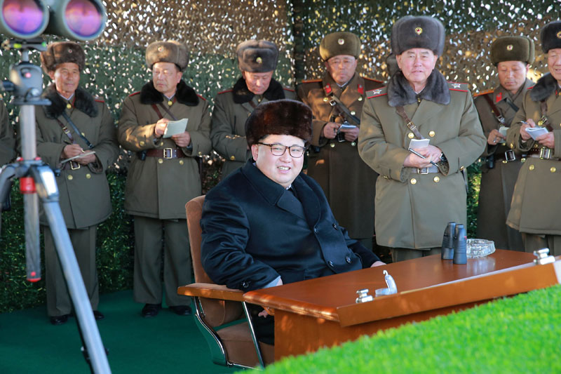 North Korean leader Kim Jong Un guides a firing contest among multiple launch rocket system (MLRS) batteries selected from large combined units of the KPA, in this undated photo released by North Korea's Korean Central News Agency (KCNA) in Pyongyang on December 21, 2016. Photo:  KCNA via Reuters