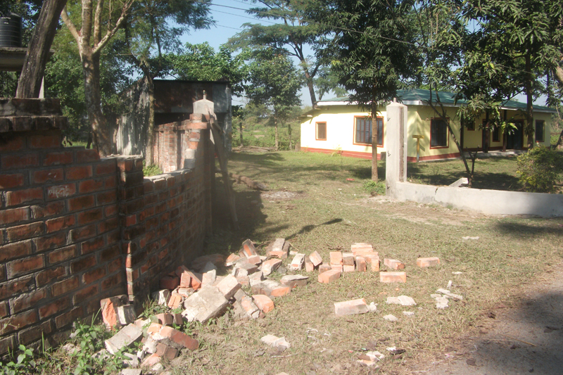 A section of the compound wall of the Koshi Tappu Wildlife Reserve office in Kushaha of Sunsari district, is broken by elephants here, on Friday, January 6, 2017. Photo: RSS