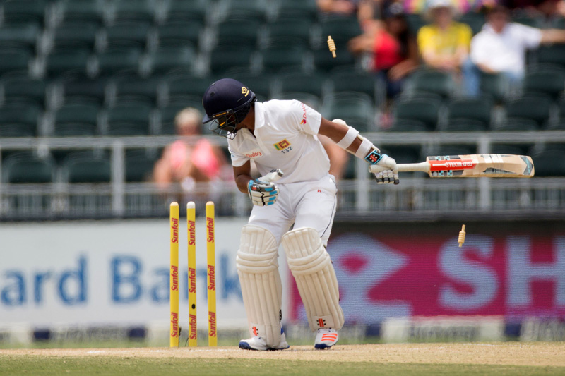 Sri Lankau2019s Kusal Mendis is bowled out by South Africa's Wayne Parnell. Photo: Reuters