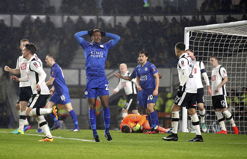 Leicester City's Demarai Gray (centre) gestures after Leicester had a shot saved during the FA Cup fourth round soccer match between Derby County and Leicester City at Pride Park, in Derby, England, on Friday, January 27, 2017. Photo: Nick Potts/PA via AP