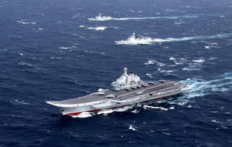 File - China's Liaoning aircraft carrier with accompanying fleet conducts a drill in an area of South China Sea, in this undated photo taken December, 2016.