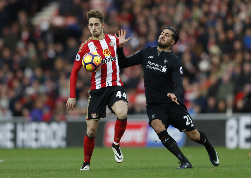 Liverpool's Emre Can in action with Sunderland's Adnan Januzaj. Photo: Reuters
