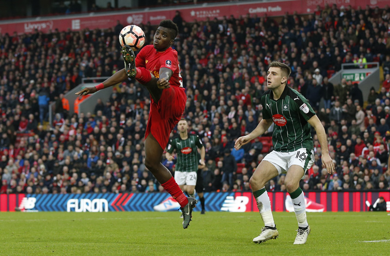 Liverpool's Sheyi Ojo in action with Plymouth Argyle's Ben Purrington. Photo: Reuters