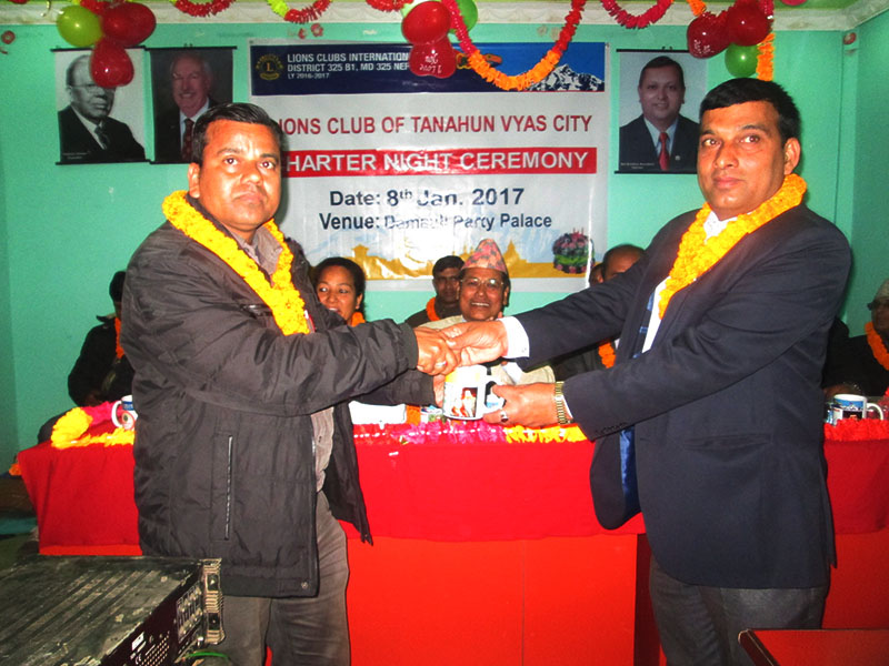 The Himalayan Times Tanahun district correspondent Madan Wagle (left) receives Lions Journalism Award at a function organised by Lions Club of Byas City, on Sunday, January 8, 2016. Photo: THT