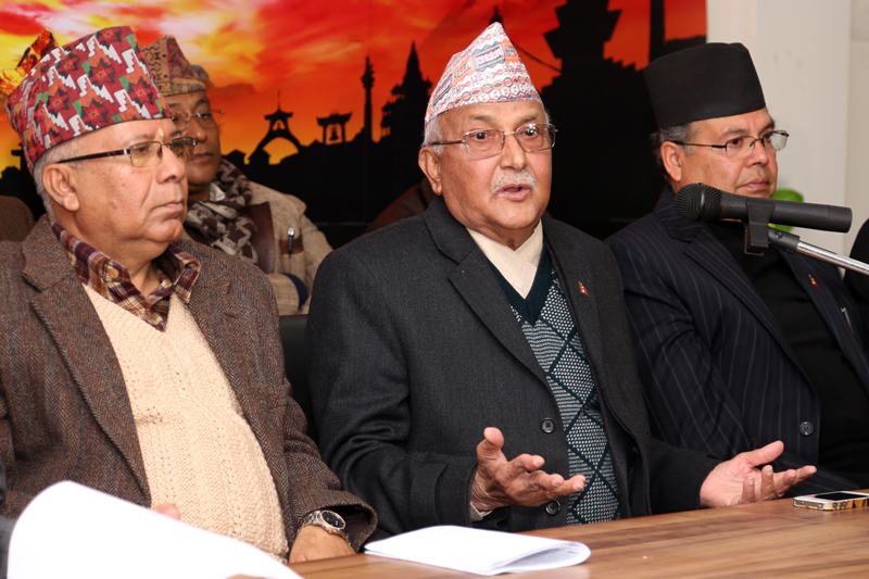 Flanked by party senior leaders Madhav Kumar Nepal (left) and Jhalanath Khanal, CPN-UML Chairman KP Sharma Oli speaks with journalists at a press meet, in Kathmandu, on Thursday, January 5, 2017. Photo: RSS