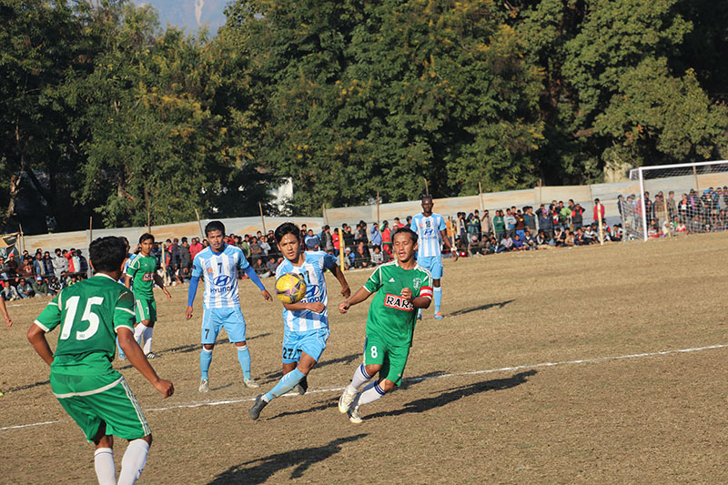 Players of Laxmi Hyundai Manang Marshyangdi Club and Sahara Club (green) in action during their semi-final match of the second Tuborg Hetauda Gold Cup International Invitational Football Tournament at the Forestry University grounds in Makawanpur on Thursday, January 5, 2017. Photo: THT