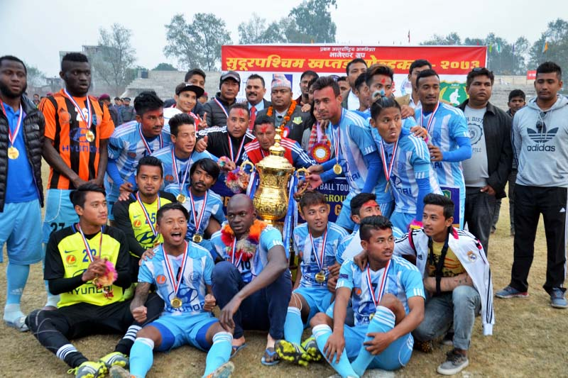 Manang Marshyangdi Club players and officials celebrate after winning the first Bhageshwor Group Far-west Khaptad Gold Cup Football Tournament at the Dhangadhi Stadium on Saturday, January 14, 2017. Photo: THT