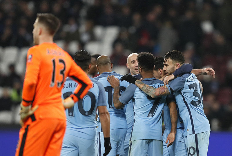 Manchester City's players celebrate their fifth goal during the FA Cup third round football match between West Ham United and Manchester City at the London stadium in London, on Friday, January 6, 2017. Photo: AP