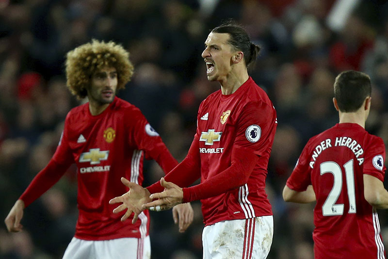 Manchester United's Zlatan Ibrahimovic (centre) celebrates scoring his side's first goal during the English Premier League soccer match between Manchester United and Liverpool at Old Trafford stadium in Manchester, England, on Sunday, January 15, 2017. Photo: AP