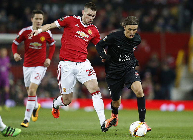 FILE - Manchester United's Morgan Schneiderlin (centre) and Midtjylland's Jakob Poulsen during the Europa League round of 32 second leg soccer match between Manchester United and FC Midtjylland in Manchester, England, on Thursday, February 25, 2016. Photo: AP