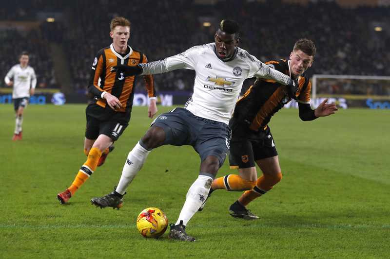 Manchester United's Paul Pogba in action with Hull City's Josh Tymon and Sam Clucas in action. Photo: Reuters